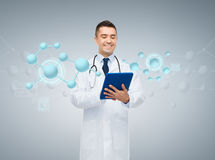 Male doctor with tablet pc and molecule formula Royalty Free Stock Photography