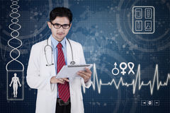 Male doctor with tablet and virtual screen Stock Image