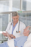 Male doctor taking care of patient royalty free stock photos