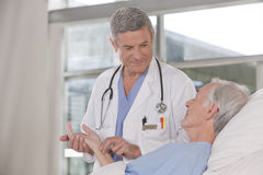 Male doctor taking care of patient Royalty Free Stock Photography