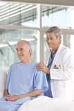 Male doctor taking care of patient stock photos