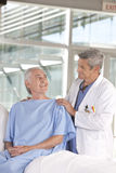 Male doctor taking care of patient royalty free stock images
