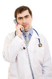 Male doctor talking on the phone. On a white background Royalty Free Stock Images