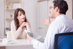 The male doctor talking to patient with nose operation surgery. Male doctor talking to patient with nose operation surgery royalty free stock images