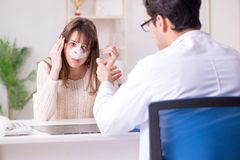 The male doctor talking to patient with nose operation surgery. Male doctor talking to patient with nose operation surgery Stock Images