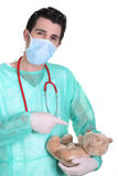 Male doctor with teddy bear Stock Photography