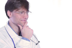 Male doctor with thoughtful expressioin Stock Photos