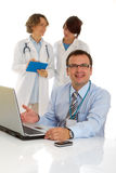 Male doctor with two of his co-workers Royalty Free Stock Images
