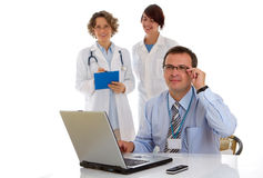 Male doctor with two of his co-workers Royalty Free Stock Photos