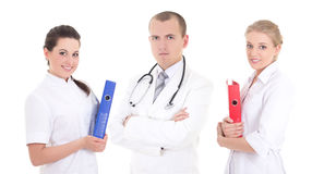 Male doctor and two young nurses with folders Royalty Free Stock Image