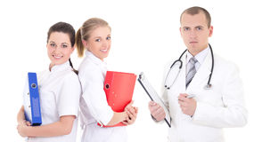Male doctor and two young nurses isolated on white Stock Photography