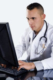 Male Doctor typing on computer. Stock image of doctor typing on computer Royalty Free Stock Image