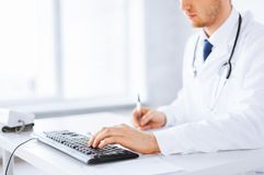 Male doctor typing  on the keyboard. Close up of male doctor typing  on the keyboard Stock Image