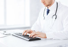 Male doctor typing  on the keyboard Stock Photo
