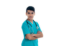 Male doctor in uniform with stethoscope smiling on camera isolated on white background. Male doctor in uniform with stethoscope smiling on camera isolated on Royalty Free Stock Photo