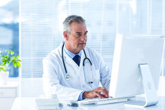 Male doctor using computer in hospital Royalty Free Stock Images