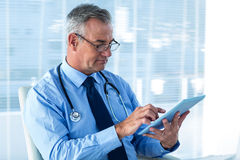 Male doctor using digital tablet in clinic Royalty Free Stock Image
