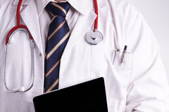 Male Doctor using a Digital Tablet Stock Photography