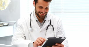 Male doctor using digital tablet stock video footage