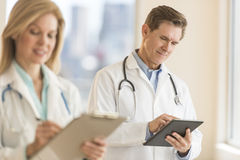 Male Doctor Using Digital Tablet At Hospital Stock Images