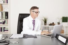Male Doctor Using Laptop Royalty Free Stock Image