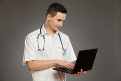Male doctor using a laptop Stock Image