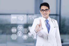 Male doctor using medical interface Royalty Free Stock Image