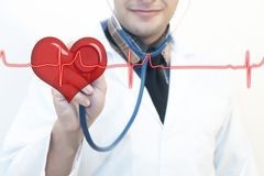 Male doctor using stethoscope heart pulse Royalty Free Stock Photo