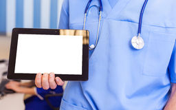 Male doctor using a tablet computer in a hospital.  Royalty Free Stock Photo