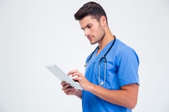 Male doctor using tablet computer Royalty Free Stock Photography