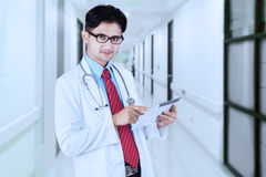 Male doctor using tablet in the hospital Stock Image