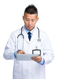 Male doctor using tablet Royalty Free Stock Image