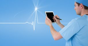 Male doctor using tablet PC with human diagram in background. Digital composite of Male doctor using tablet PC with human diagram in background Stock Photo