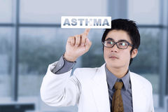 Male doctor with virtual asthma word Royalty Free Stock Photography