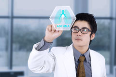 Male doctor with virtual lungs symbol Stock Photography
