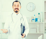 Male doctor waiting for patients Stock Photography