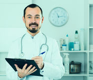 Male doctor waiting for patients Royalty Free Stock Photo