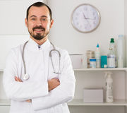 Male doctor waiting for patients Stock Photo