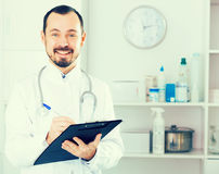 Male doctor waiting for patients Royalty Free Stock Photos