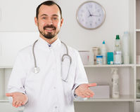 Male doctor waiting for patients Stock Photos