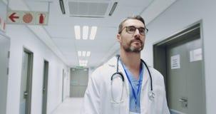 Male doctor walking in hospital corridor 4k stock video