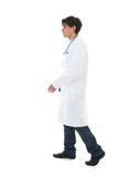 Male doctor walking near by Royalty Free Stock Photo