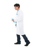 Male doctor walking near by Royalty Free Stock Photos