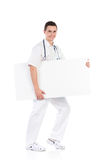 Male doctor walks with an empty banner Stock Photo
