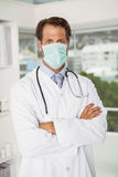 Male doctor wearing surgical mask in hospital. Portrait of a male doctor wearing surgical mask in the hospital Royalty Free Stock Photos