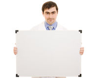 Male doctor with a white board. On a white background Royalty Free Stock Photography
