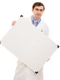 Male doctor with a white board. Male doctor holding a white board on a white background Stock Image