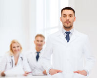 Male doctor in white coat Stock Images
