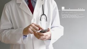 Male doctor in white coat is using a modern smartphone device Stock Photo