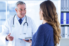 Male doctor with woman in clinic Royalty Free Stock Image